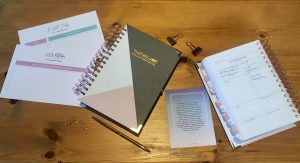 Happiness Planners on table