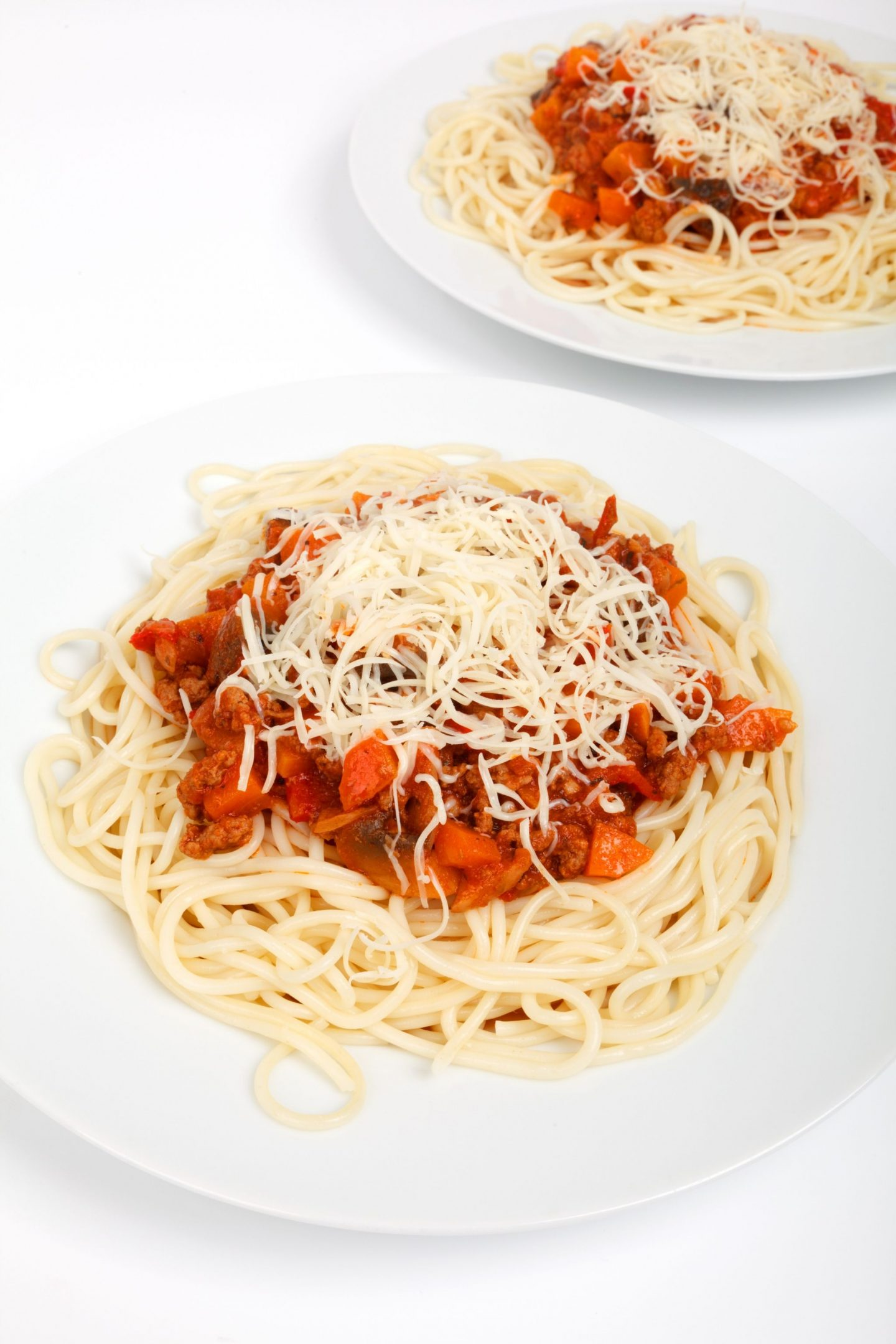 Two plates of spaghetti bolognese